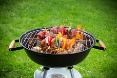 Fresh skewers on the grill. Royalty Free Stock Photos