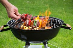 Fresh skewers on the grill. Stock Image