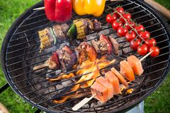Fresh skewers on the grill. Royalty Free Stock Images