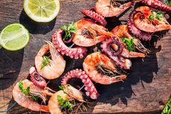 Fresh skewers of seafood with lemon and parsley in garden Stock Photography