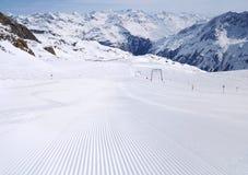 Fresh ski track at Soelden ski zone. Untouched ski track at Soelden ski zone with lines and beautiful mountains at background Stock Photography