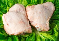 Fresh skinless chicken thighs on salad Royalty Free Stock Photography