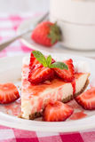 Fresh Slice of Cheesecake with Strawberries and Coffee Cup Stock Photo