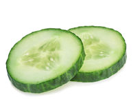 Fresh slice cucumber close-up on a white background. Royalty Free Stock Photo