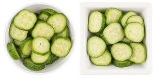 Fresh slice cucumber in white bowl on white background. Top view Fresh slice cucumber in white bowl on white background Stock Image