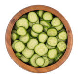 Fresh slice cucumber in wood bowl on white background Stock Photo