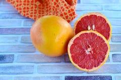 Fresh slice of grapefruit. Horizontal image Royalty Free Stock Photo
