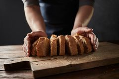 Free Fresh Slice Home Bread In Male`s Hands On Wooden Table Royalty Free Stock Images - 115582839