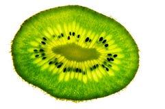 A slice of kiwi. A fresh slice of kiwi fruit Royalty Free Stock Photo