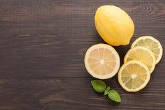 Fresh slice lemon on the wooden background stock image