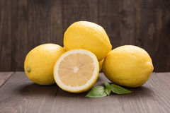 Fresh slice lemon on the wooden table Royalty Free Stock Photography