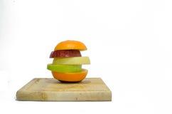 Fresh slice mixed fruits  on white background Stock Image