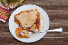 Fresh slice of peach pie Stock Images