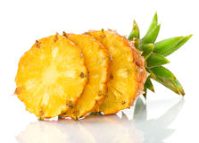 Fresh slice pineapple. On the white background Royalty Free Stock Photo