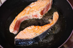 Fresh slice of salmon. In the frying pan Stock Photography