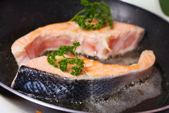 Fresh slice of salmon. In the frying pan Stock Photos