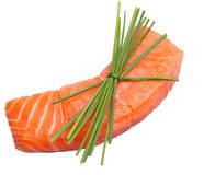 Fresh slice of salmon with chives. Isolated on white background Stock Photo