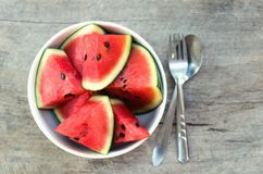 Fresh slice of watermelon in cup on woods Stock Photography