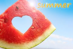 Fresh slice of watermelon with heart inside. On blue sky background, with inscription summer royalty free illustration