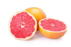Fresh sliced fruit grapefruits. Ripe tasty grapefruits on white background Royalty Free Stock Photo