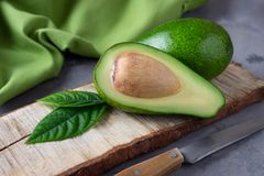 Fresh sliced avocado on cutting board royalty free stock image