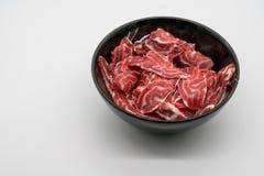 Fresh sliced beef hind shank in black ceramic bowl Stock Image