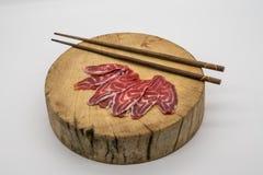 Fresh sliced beef hind shank on chopping board Stock Photo