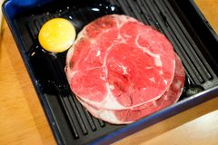 Fresh sliced beef with yolk egg. Prepare for cooking Royalty Free Stock Photo