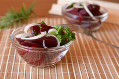 Fresh sliced beetroot salad with onion and parsley on a glass bowl Royalty Free Stock Image