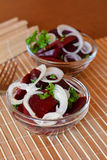 Fresh sliced beetroot salad with onion and parsley on a glass bowl Stock Photo