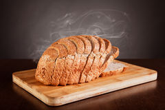 Fresh sliced bread. With smoke, studio shot Royalty Free Stock Photo
