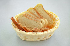 Fresh sliced  bread in a basket on a gray background. For design Royalty Free Stock Images