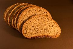 Fresh sliced bread on dark background. Healthy and useful.make you power up Stock Photos