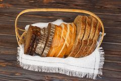 Fresh sliced bread and loaf on bascet, closeup.  Royalty Free Stock Image