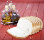 Fresh sliced bread with oil and vinegar. On table Royalty Free Stock Photo