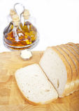 Fresh sliced bread with oil and vinegar. On white background Royalty Free Stock Photos