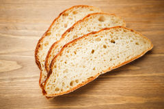 Fresh sliced bread. On wooden plank Stock Images