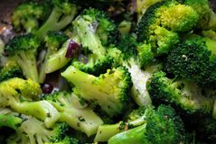 Fresh sliced broccoli with red onion on a plate stock photography