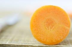 Haft carrot on wooden, detail. Fresh sliced carrot on wooden, detail Royalty Free Stock Photography