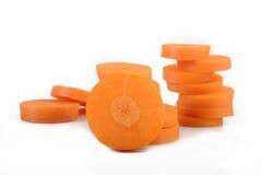 Fresh sliced carrots on white. Background Stock Photo