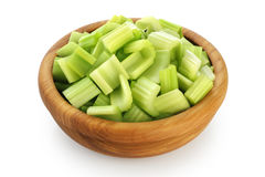 Fresh sliced celery in a wooden bowl isolated on white backgroun Royalty Free Stock Images