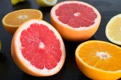Fresh sliced citrus on a slate platter Royalty Free Stock Image