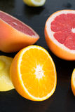Fresh sliced citrus on a slate platter Royalty Free Stock Photography