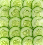 Fresh sliced cucumber on background,Pieces of fresh cucumber. Fresh sliced cucumber on background royalty free stock photo