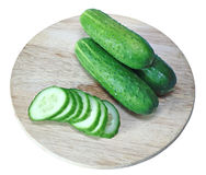 Fresh sliced cucumber on board isolated Royalty Free Stock Photos
