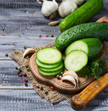 Fresh sliced cucumber on a wooden board Stock Photo