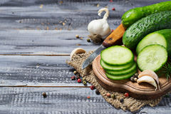Fresh sliced cucumber on a wooden board Royalty Free Stock Images