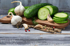 Fresh sliced cucumber on a wooden board Royalty Free Stock Photo