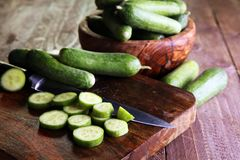Fresh and sliced cucumbers. Sliced cucumbers on a cutting board. Royalty Free Stock Photo