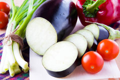 Fresh sliced eggplant and vegetables Stock Images
